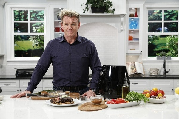 gordon ramsay posing with philips air fryer
